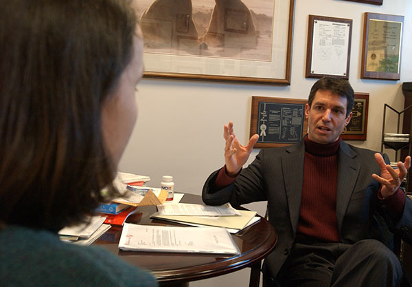 David L. Katz MD having discussion in office